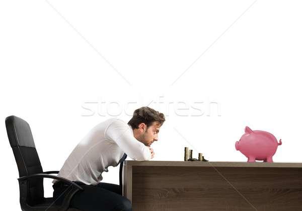 Spaargeld man triest kijken geld zakenman Stockfoto © alphaspirit