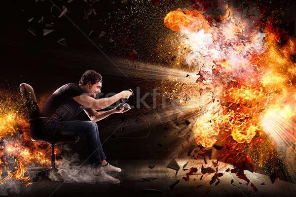Világ férfi botkormány videojáték tűz technológia Stock fotó © alphaspirit