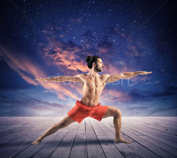 Yoga ciel étoiles homme poste fitness Photo stock © alphaspirit