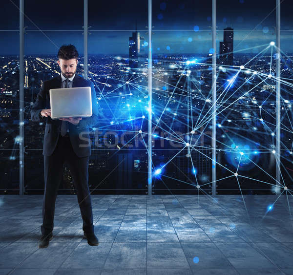 Businessman works with laptop and internet network Stock photo © alphaspirit