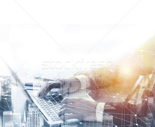 Businessperson in office connected on internet network with laptop Stock photo © alphaspirit