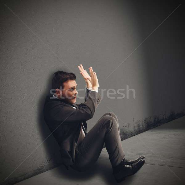 Businessman destroyed afraid Stock photo © alphaspirit