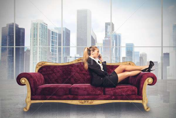 Businesswoman on sofa Stock photo © alphaspirit