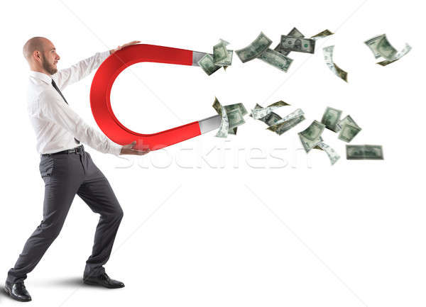 Businessman attracts money Stock photo © alphaspirit