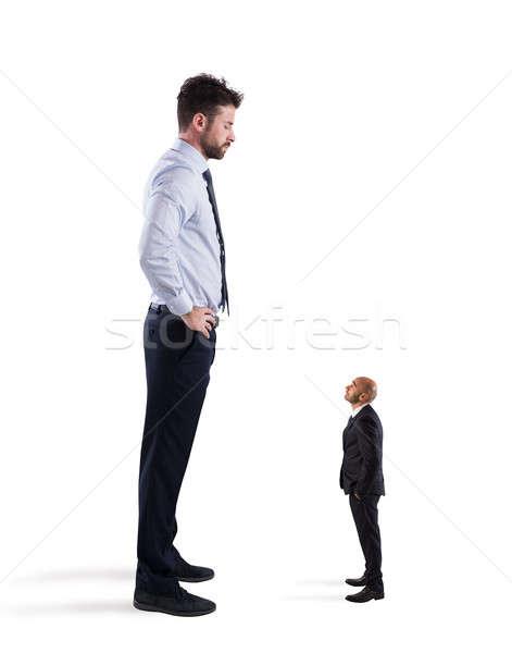 Small businessman terrified by his big boss Stock photo © alphaspirit