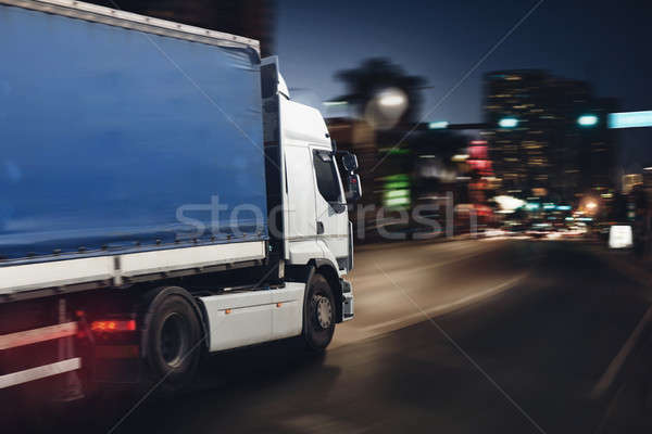 Fast truck on a city road delivering at night Stock photo © alphaspirit