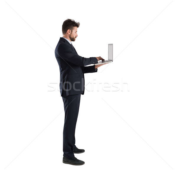 Businessman connected on internet network with his laptop. Isolated on white background Stock photo © alphaspirit