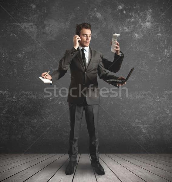 Businessman multitasking Stock photo © alphaspirit