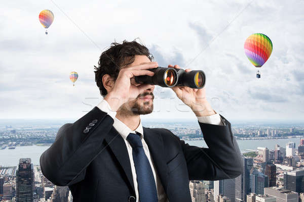 Businessman looking to the future and new opportunities Stock photo © alphaspirit