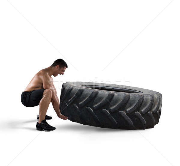 Workout with a big tire Stock photo © alphaspirit