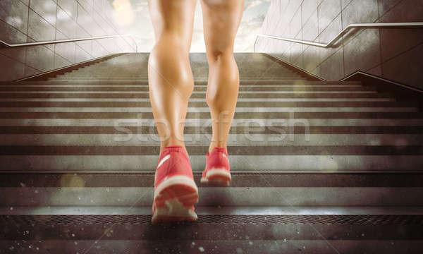 Legs of a girl running Stock photo © alphaspirit