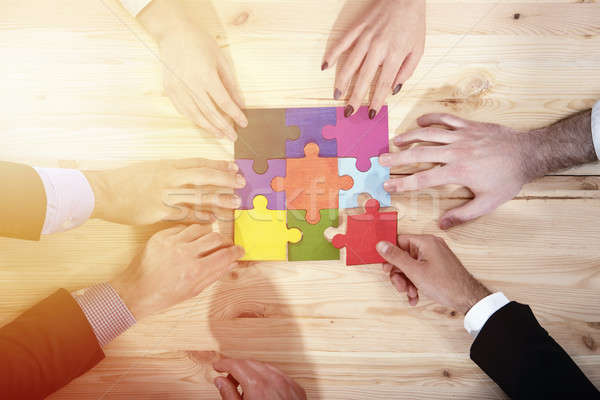 Teamwork of partners. Concept of integration and startup with puzzle pieces Stock photo © alphaspirit