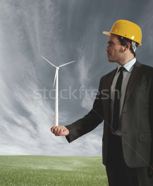 Businessman and wind turbine Stock photo © alphaspirit