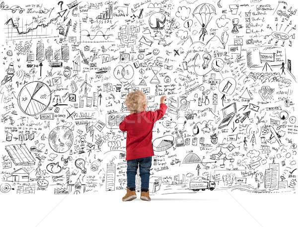 Weinig financiële genie kinderen diagrammen statistiek Stockfoto © alphaspirit