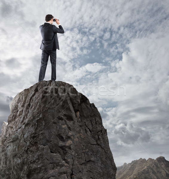Businessman searchs for new horizon, new business opportunities Stock photo © alphaspirit