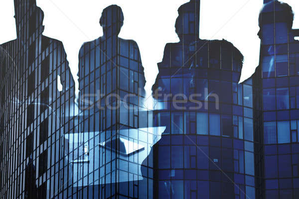 Businessmen that work together in office. Concept of teamwork and partnership Stock photo © alphaspirit