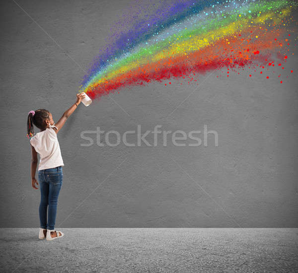Child draws with spray the color of peace Stock photo © alphaspirit