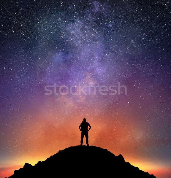 Excursionist observe a bright sky Stock photo © alphaspirit