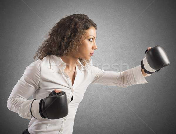 Punch of businesswoman Stock photo © alphaspirit