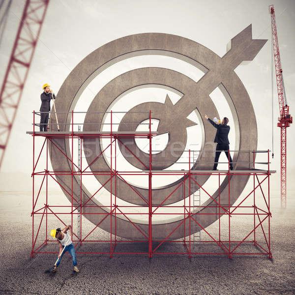 Trabalho em equipe construir negócio alvo misto mídia Foto stock © alphaspirit