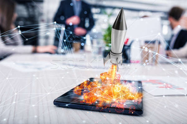Rocket ready to starts from a tablet. concept of company startup Stock photo © alphaspirit