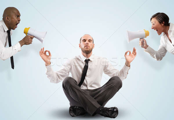 Impassive businessman despite the screams Stock photo © alphaspirit