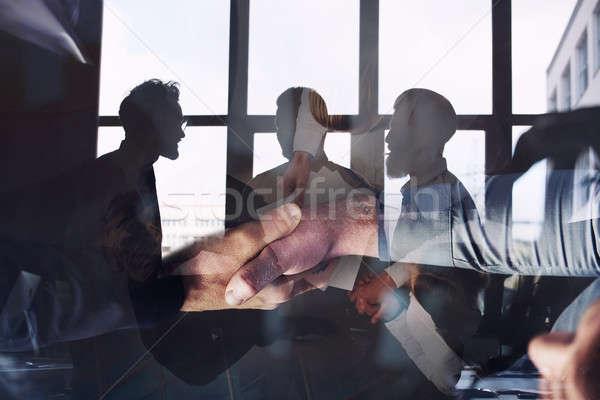 Empresário escritório trabalho em equipe dobrar exposição Foto stock © alphaspirit