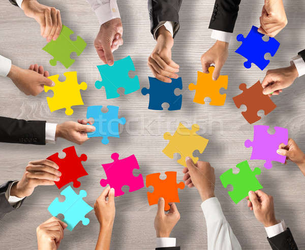 Teamwork and integration concept with puzzle pieces Stock photo © alphaspirit