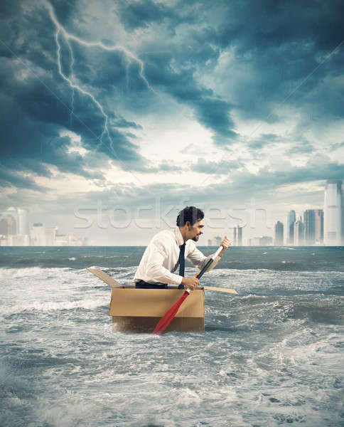 Paddling in the storm Stock photo © alphaspirit