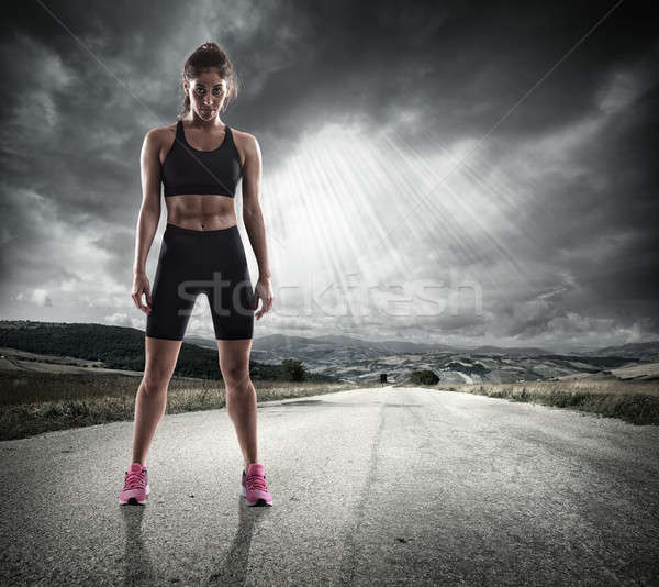 Athletic woman runner Stock photo © alphaspirit