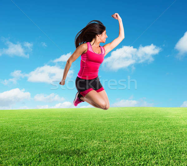 Vital and athletic girl jumps Stock photo © alphaspirit