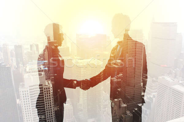 Handdruk twee kantoor blootstelling Stockfoto © alphaspirit