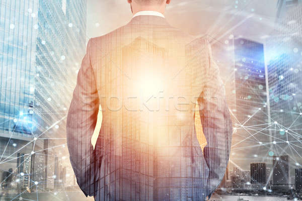 Businessman looks far for the future with internet network effect Stock photo © alphaspirit