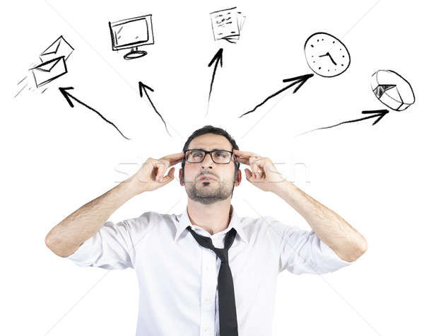 Stressed businessman tries to plan his work day Stock photo © alphaspirit