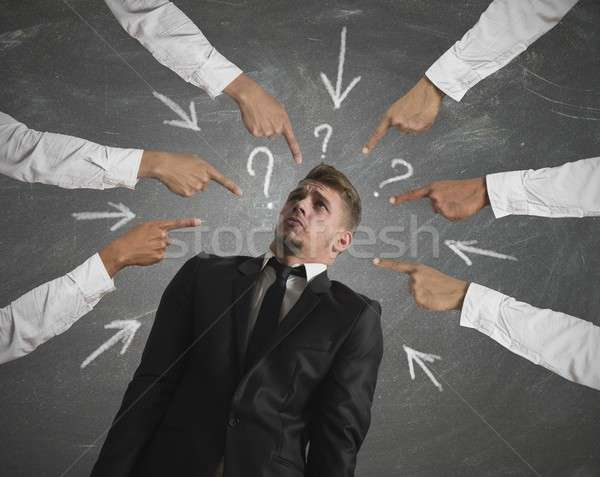 Accused businessman Stock photo © alphaspirit