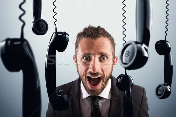 Stressful phone calls Stock photo © alphaspirit