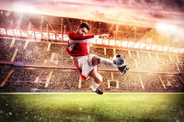 Stadion voetballer spelen publiek man Stockfoto © alphaspirit