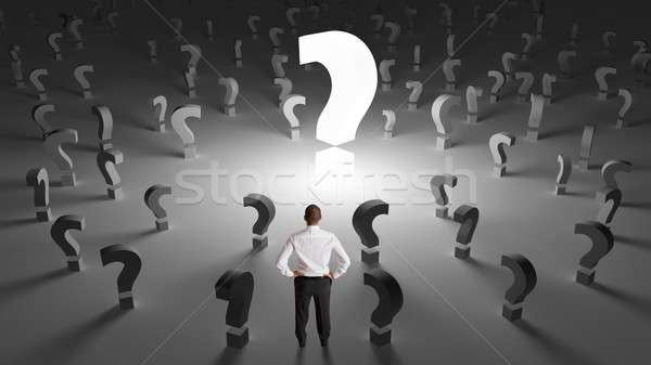 Businessman with many questions Stock photo © alphaspirit