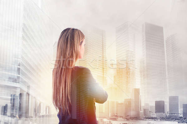 Businesswoman looks far for the future Stock photo © alphaspirit