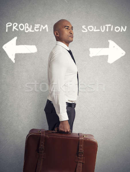 Stock photo: Businessman must choose between different destinations. concept of difficult career