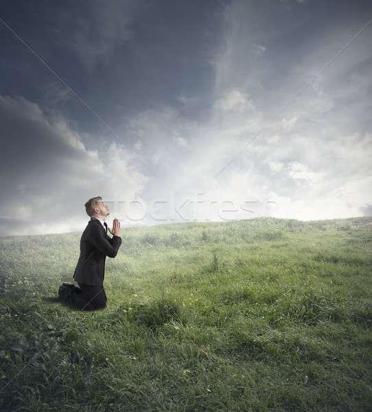 Businessman praying Stock photo © alphaspirit