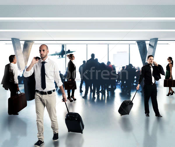 Busy businesspeople in the airport Stock photo © alphaspirit