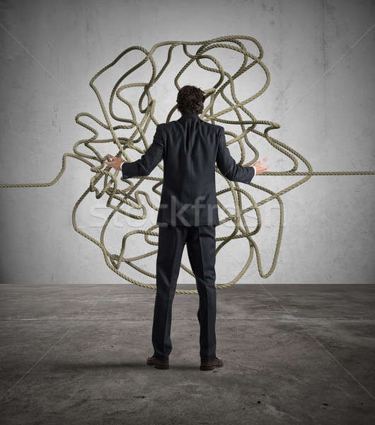 Businessman resolves the tangle Stock photo © alphaspirit