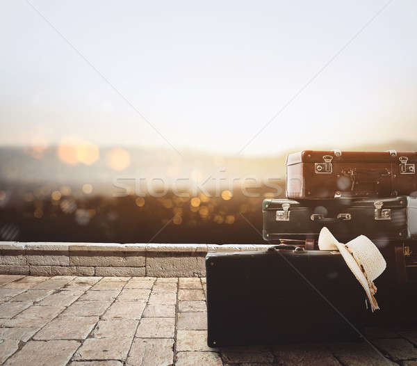 Luggage resting on a stone pavement Stock photo © alphaspirit