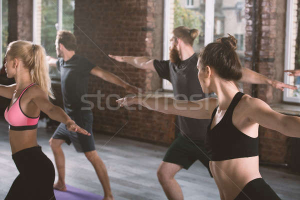 People do stretching at the gym Stock photo © alphaspirit