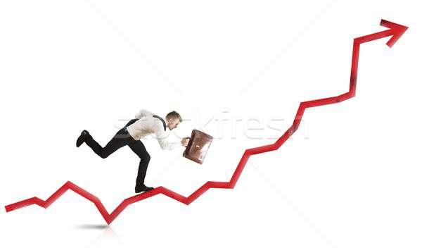 Businessman rises statistics Stock photo © alphaspirit