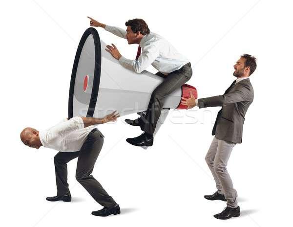 Megcélzott marketing határozott üzletemberek magasra tart nagy Stock fotó © alphaspirit