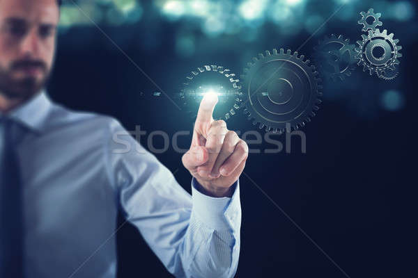 бизнеса работу передач механизм бизнесмен прикасаться Сток-фото © alphaspirit