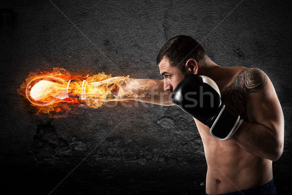 Confident boxer with fiery boxing gloves Stock photo © alphaspirit