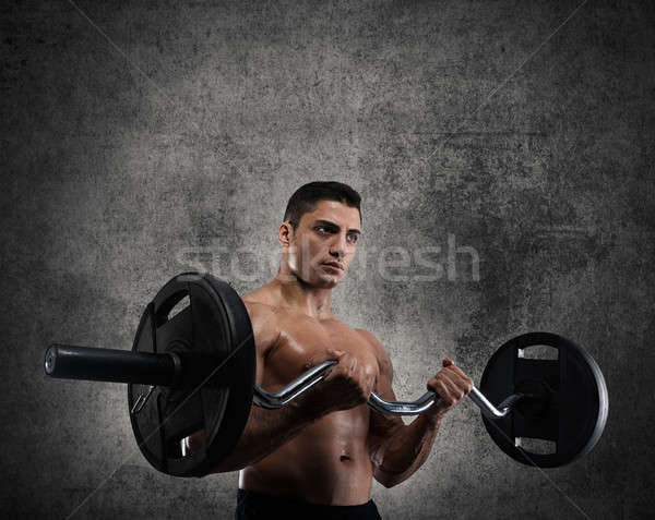 Athletic man training biceps Stock photo © alphaspirit